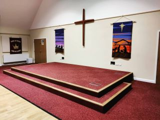 Busy day finishing up this bespoke stage 🔨📏 Trimmed in solid oak with built-in storage and floor boxes with angled socket plates - CNC machined in house 😍 #dmmusic #avinstaller #soundsystems #carpentry #stage #church #bespoke #custom #installation #churchav